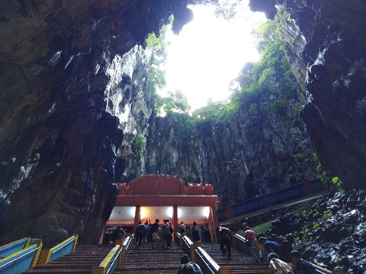 The Batu Caves cliff has a small opening above from where the sky can be see